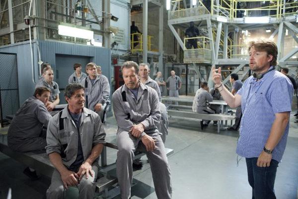 Stallone, Schwarzenegger und Regisseur Mikael Håfströmin beim Dreh zu 'Escape Plan'